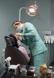 Dental surgery office. Doctor and patient in stomatological office royalty free stock photos