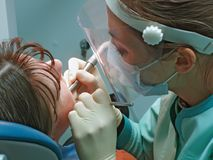 Dental surgery office. Doctor and  patient in stomatological office Stock Image
