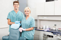 Dental Team. Portrait of a confident male and female dentists smiling at dental clinic royalty free stock photo