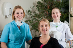 Dental team and patient. Dental team and a patient ready to start working Royalty Free Stock Photo