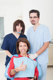 Dental team taking care of female patient Royalty Free Stock Photo