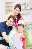 Dental team and young patient showing like Stock Image