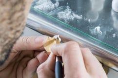 Dental technician applying ceramics to teeth in the dental model Stock Photos