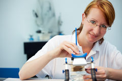 Dental technician with articulator Royalty Free Stock Images