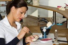Dental technician. Beautiful dental technician working in a dental laboratory Stock Images
