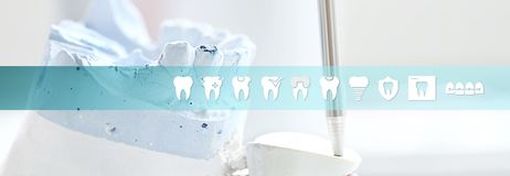 Dental technician concept articulator tool with teeth icons and Stock Image