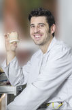 Dental technician with a dental model in his hand. Royalty Free Stock Images