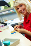Dental technician grinding Stock Photography