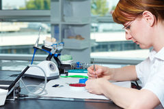 Dental technician at her desk Stock Photography