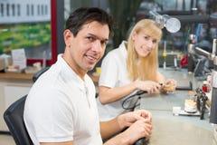 Dental technician polishing gold tooth Stock Photos
