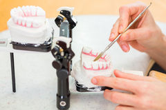 Dental technician producing denture Royalty Free Stock Images