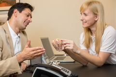 Dental technician showing prosthesis to a customer Stock Photos
