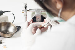 Dental technician working with articulator royalty free stock photos