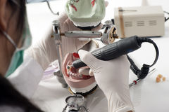 Dental technician working with articulator Stock Photos
