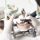 Dental technician working with articulator Royalty Free Stock Image