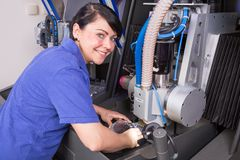 Technician in a dental lab working at a drilling or milling machine Royalty Free Stock Photos