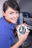 Technician in a dental lab working at a drilling or milling machine Stock Photography