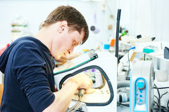 Dental technician working with tooth dentures Stock Photos