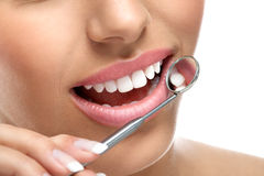 Dental teeth. Beautiful smile with dental mirror Stock Photo