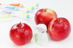Dental teeth floss, toothbrush and red apple royalty free stock image