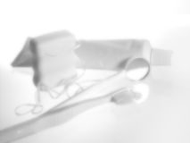 Dental Tools. White dental objects: toothpaste, toothbrush, mirror and floss Royalty Free Stock Photos