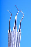 Dental Tools on blue background Royalty Free Stock Photography
