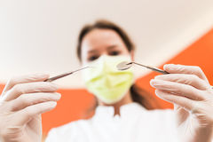 Dental tools on dentist's hands Stock Images