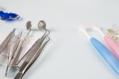 Dental tools and retainer. Dental  tools  and retainer orthodontic appliance on the blue background Stock Photos
