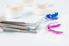 Dental tools and retainer. Dental  tools  and retainer orthodontic appliance on the blue background Stock Photography