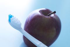 Dental toothbrush and apple Stock Image