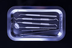 Dental tray with dental tools on black background Stock Photo