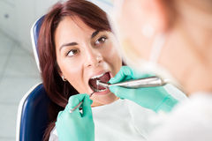 Dental treatment with dental drill Stock Images