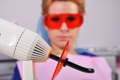 Dental ultraviolet light tool Stock Images