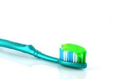 Dente-spazzola con il dentifricio Immagine Stock