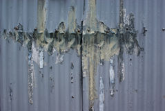 Dented and Peeling Corrugated Iron Wall Stock Photography