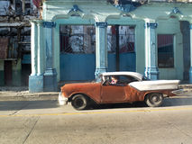Dented vintage car in Havana. Stock Photos