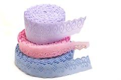 Dentelle de bleu, de rose et de lilas Images stock