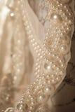Dentelle de mariage avec des perles Images stock