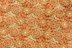 Dentelle orange sur le fond blanc Aucune n'importe quelle marque déposée ou ne limitent la matière en cette photo Photos stock