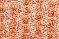 Dentelle orange sur le fond blanc Aucune n'importe quelle marque déposée ou ne limitent la matière en cette photo Images stock
