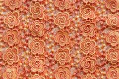 Dentelle orange sur le fond blanc Aucune n'importe quelle marque déposée ou ne limitent la matière en cette photo Photo libre de droits