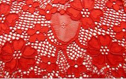 Dentelle rouge avec la texture de fleurs Images stock