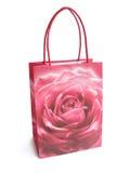 Dentelli il sacchetto di acquisto brillantemente colorato isolato sopra un backgro bianco Fotografia Stock