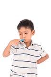 dentes asiáticos pequenos da escova do menino imagens de stock royalty free