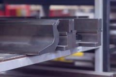 Dentes da máquina para dobrar-se fotografia de stock