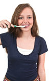 Dentes de escovadela da mulher adolescente bonita fotos de stock royalty free