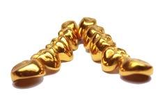 Dentes do ouro Fotografia de Stock