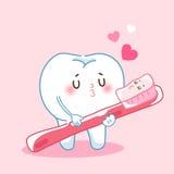 Dentes e escova de dentes dos desenhos animados ilustração royalty free
