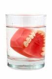 Dentes no vidro Fotografia de Stock