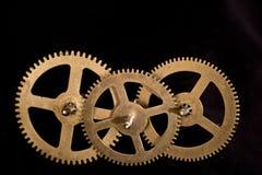 Denti dell'orologio di Steampunk su fondo nero Immagine Stock